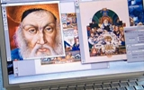 Reviewing Digital Photos of Original Haggadah Artwork.